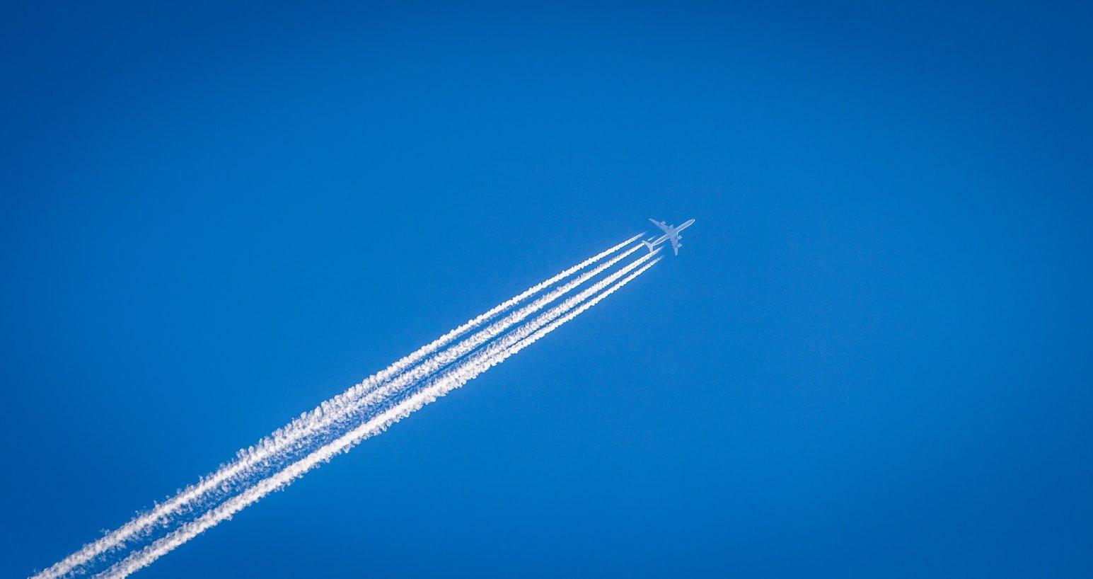Plane in sky cloud smoke trail